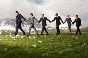 Business People Holding Hands and Walking