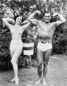 Actress Dorothy Wilson Posing with Charles Atlas